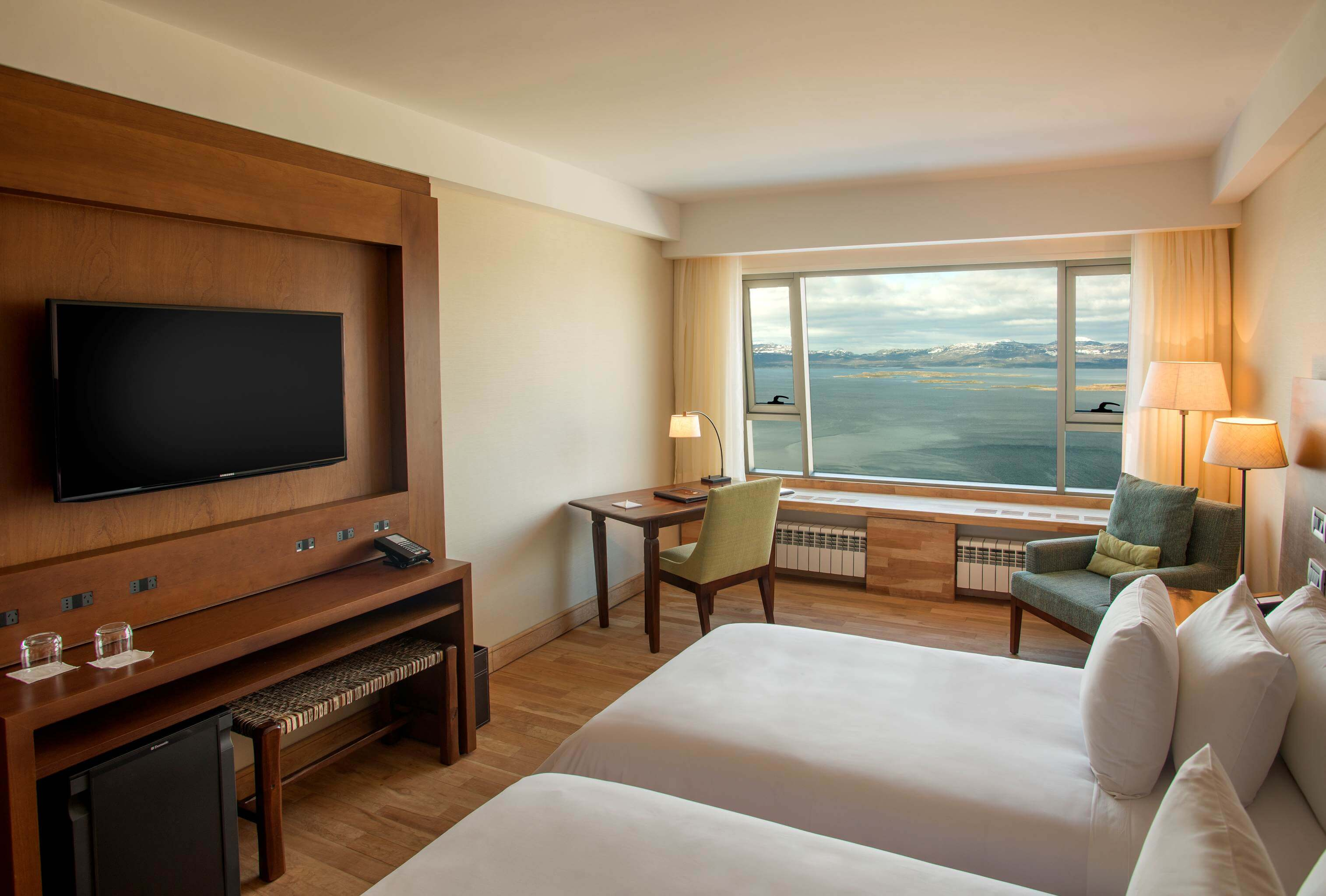 Hotel Arakur Ushuaia, Argentina. Double superior room with two single beds, tv, desk and view of the bay.